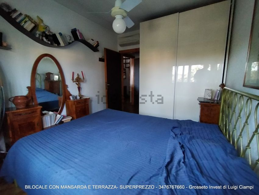 Grosseto Invest Vende - Camera da lettodel bilocale con mansarda in Viale Uranio,, Grosseto