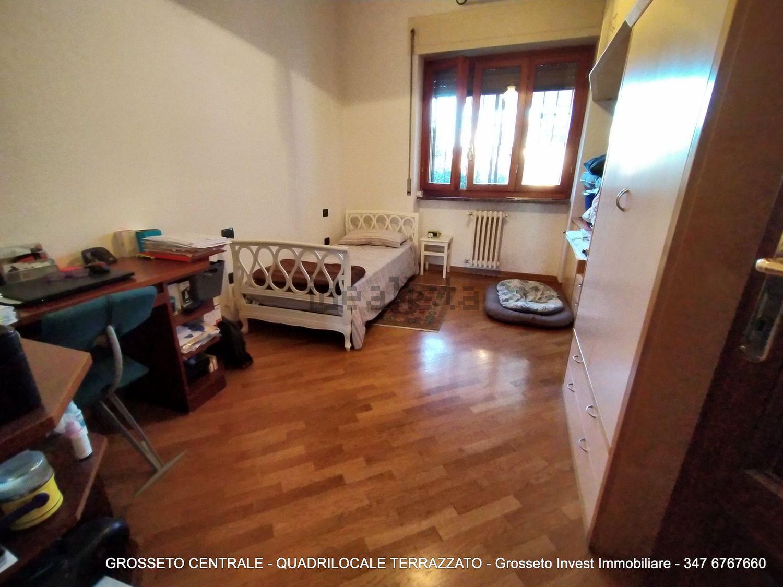 Grosseto Invest di Luigi Ciampi vendita appartamento Camera da letto di quadrilocale su  Agostino de pretis, 10, Centro, Grosseto